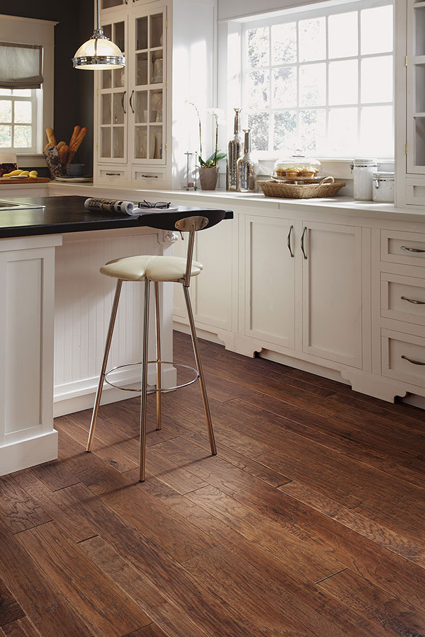 Laminate Vs Hardwood Flooring Resale Value Mid-toned kitchen hardwood flooring. Cost vs. Value ...