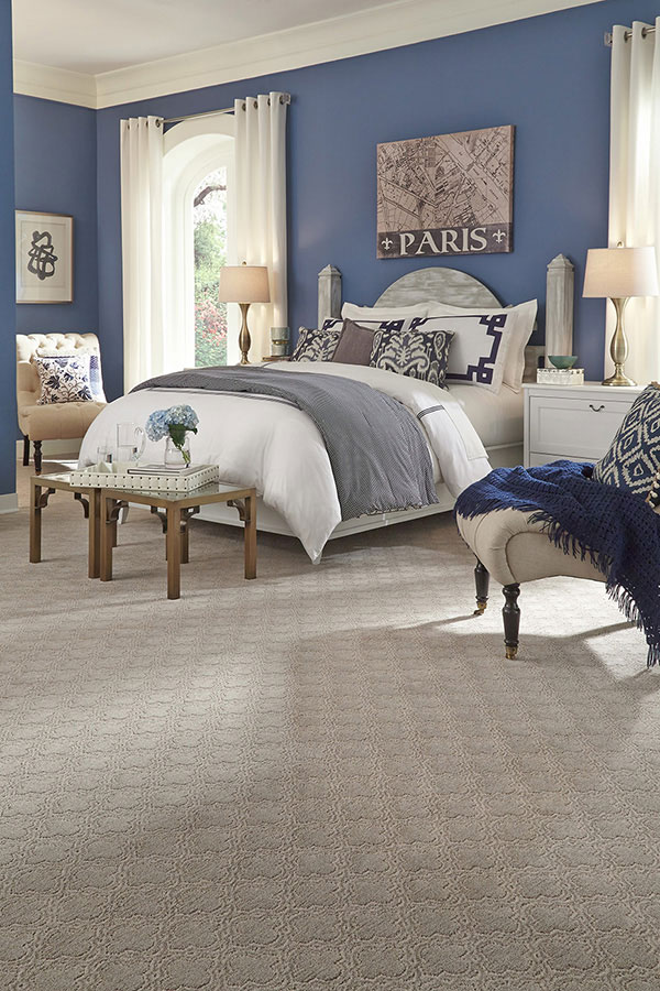 Light colored carpet in a master bedroom