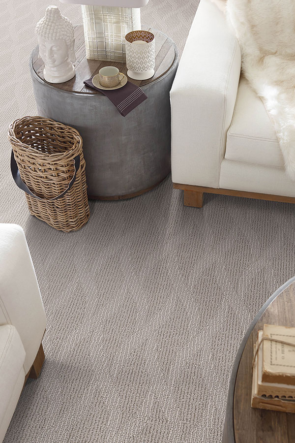 Grey patterned carpet in a living room