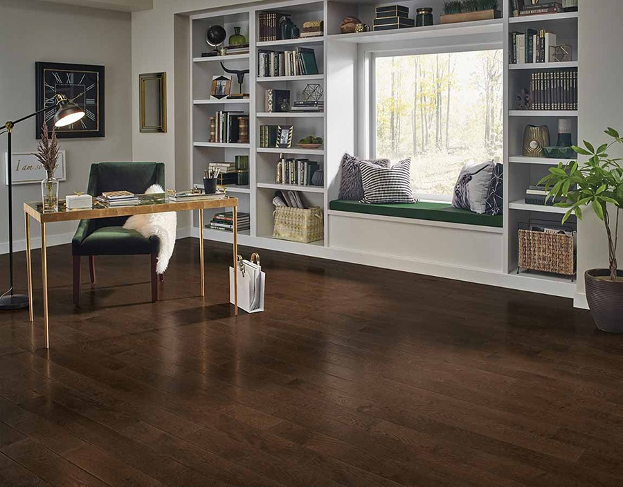 Spacious home office with dark wood flooring