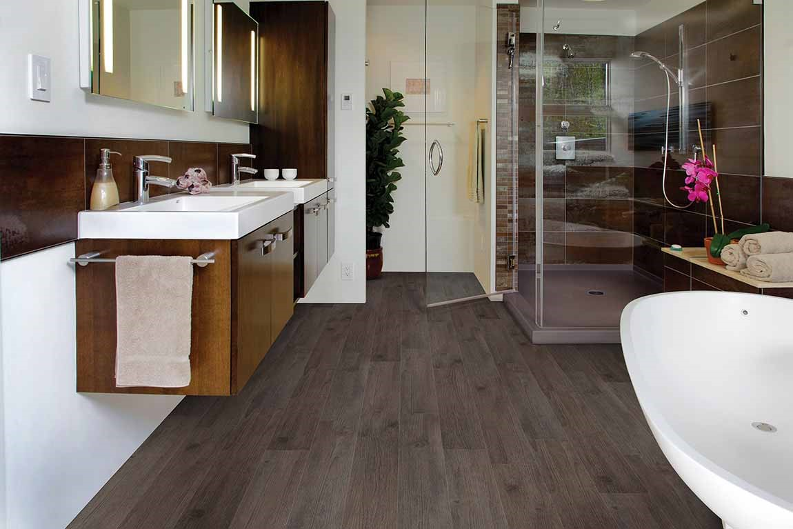bathroom with lvt wood look flooring and floating vanity