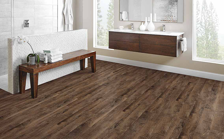 Large bathroom with dark hardwood flooring and floating style sink