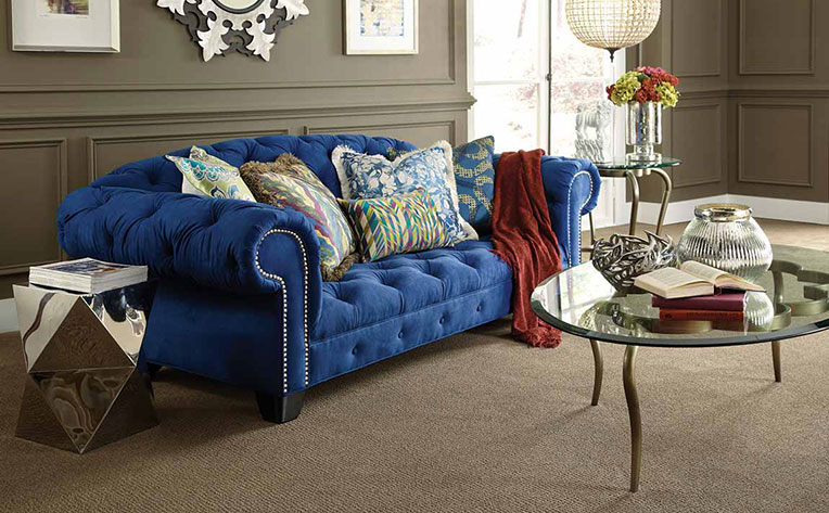 Living Room with a royal blue couch as a statement piece of furniture