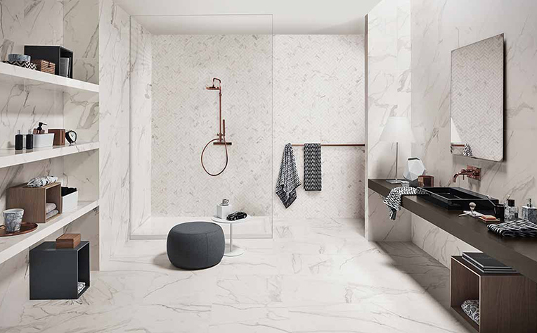 Large white marble bathroom with large shower