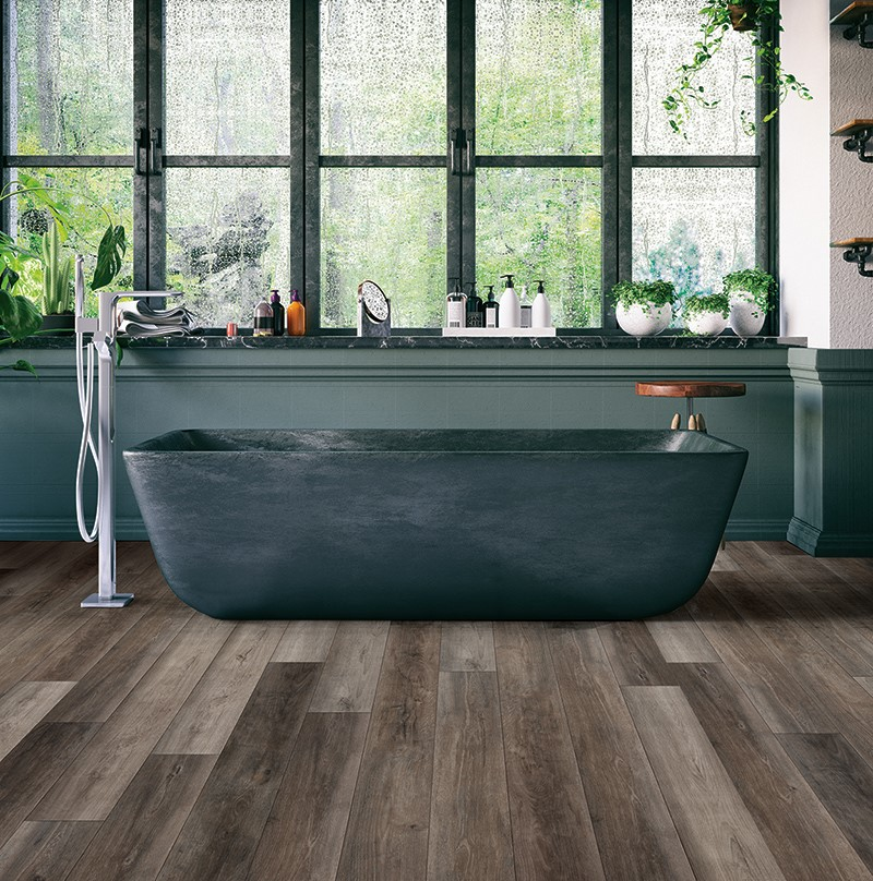 Freestanding Bathtub with Dark Hardwood LVT
