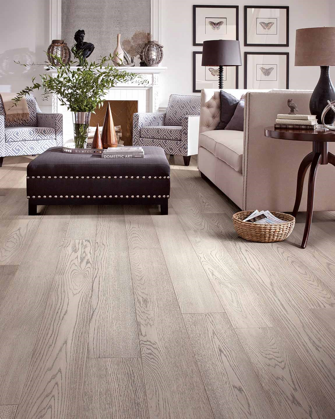 wire brushed light colored flooring in classically styled living room